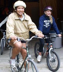 Girls Biking Around Camp Kupugani
