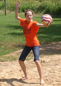 Camper Playing Sand Volleyball on the Beach at Camp Kupugani