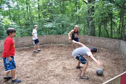 A group of boys playing GaGa which is an exciting version of dodgeball at Camp Kupugani
