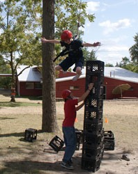 Camper crate stacking is an extremely fun activity, which tests a campers' balance and coordination at Camp Kupugani