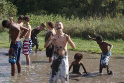 Group of campers playing mud volleyball
