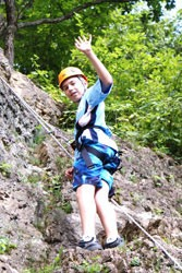 Camper rock climbing at Camp Kupugani