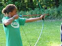 Camper Testing Her Skills in Archery at Camp Kupugani