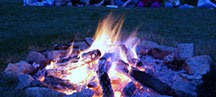 Campers Surround the Fire at Night as they Sing Camp Songs and Share Story with Each Other at Camp Kupugani