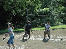 Campers playing our one-of-a-kind mud volleyball