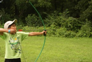 Camper testing his archery skills at our midwest summer camp