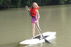 Camper enjoying stand up paddleboarding