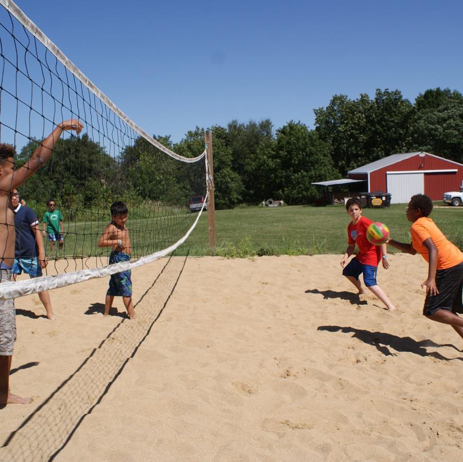 Campers playing Sand Volleyball at Camp Kupugani