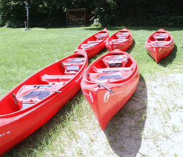 Whether you're canoeing in camp up the Leaf River for an hour, paddling around the lake, or practicing canoe tipping on a sunny day, there's something about the peacefulness of the trees, the smell of the fresh air, and the slight sound of a paddle dipping into the water that makes for a wonderful summer day activity. Our canoeing program focuses on teaching campers the fundamentals. We have high-quality 14-foot and 16-foot synthetic canoes. Whether you're experienced or a rookie, you learn as much as you want to about canoeing. Instruction is focused on teaching safety, strokes, steering and portaging. Campers are also able to canoe for a mile without leaving camp!
