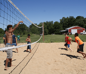 Our beach volleyball court allows volleyball lovers to play a rousing game of 2 on 2 up through full 6 on 6 games. As with all of our sports activities, we emphasize sportsmanship, effort, maintaining a positive attitude, developing skills and teamwork, and learning the rules of the game.