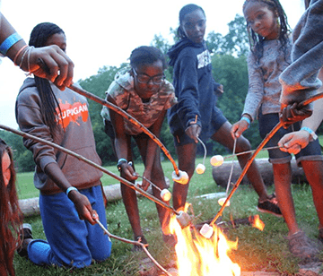 Campfires. There's something hypnotizing about the crackle and colors of each flame. And it's even more magical when the fire is surrounding by campers singing, sharing their camp experiences, and listening to stories around the campfire.