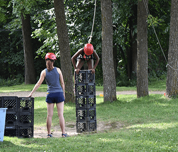 Crate stacking is an extremely fun activity, which tests campers' balance and coordination, while also requiring teamwork. The object of the activity is to construct a tower of crates while balancing and climbing. Campers enjoy the challenge and self-esteem building experience that comes with trying to climb as high as possible. Our experienced instructors talk you through every step with extreme safety in mind.