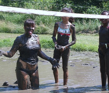 Our one-of-a-kind mud volleyball court could serve as an area for a serious game of competitive volleyball, but most of the time, it provides the venue for sticky, muddy, messy fun! Choose this activity and get ready to get dirty!
