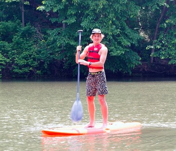 Stand-Up Paddleboarding on the Leaf River at Camp Kupugani